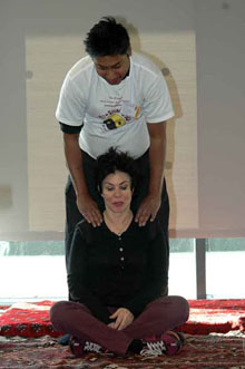 Ken giving shiatsu therapy to Ruby Wax at an event in London